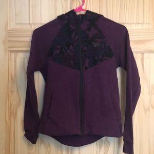 A purple zip up hoodie